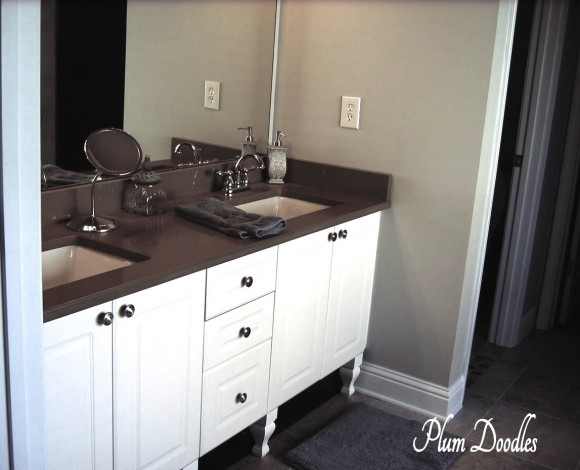 Make a bathroom vanity look like a custom piece of for Making a bathroom cabinet